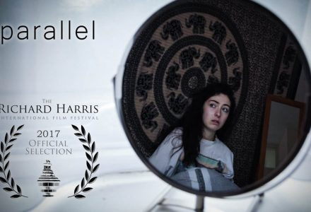 Poster for Parallel - a woman's reflection in a round mirror